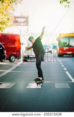 Pro Skateboarder Ride Skateboard On Capital Road Street Through Traffic