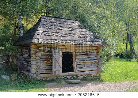The picture was taken in Ukraine in Kolochava village. In the photo there is an old village barn for livestock.