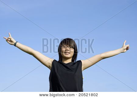 Outstretched arms asian teen girl
