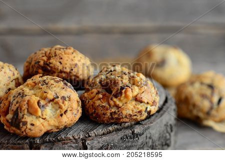 Homemade nut biscuits on a wooden background. Sweet pastry with walnuts. Closeup