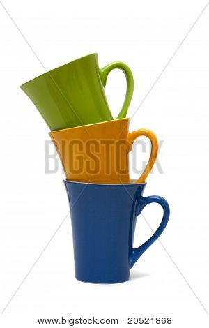 Stack of multicolored cups isolated on white background