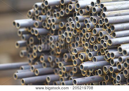 Metal profile pipe of round section in packs at the warehouse of metal products Russia