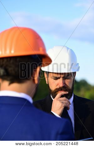 Worker And Engineer Hold Meeting. Architect With Puzzled Face