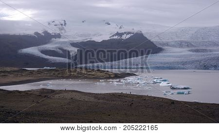 Fjallsárlón glacial lagoon and two glacier tongues which they are a part of Vatnajökull glacier, Iceland