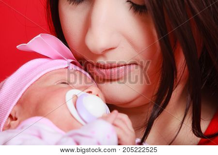 Family parenting beauty of motherhood concept. Mother holding her little newborn baby