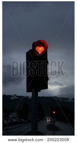 A red hearth on semaphore in Akureyri city centre, Iceland