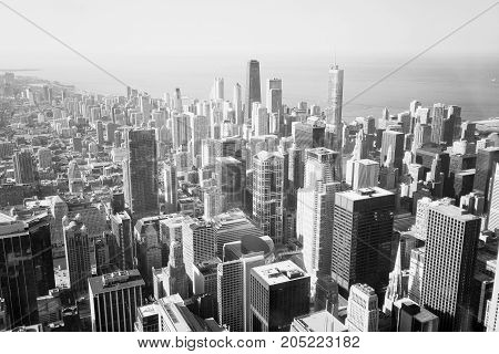 Chicago skyline and lake Michigan. An overhead view of the great city of Chicago downtown taken from the Willis (Sears) Tower. Horizontal composition in black and white.