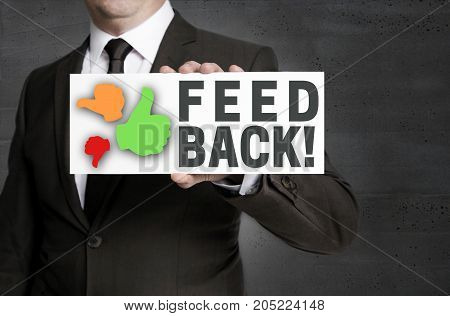 Feedback sign is held by businessman picture