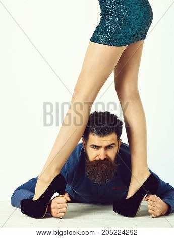 Bearded Man With Sexy Female Legs Has Serious Face