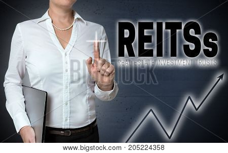 Reits touchscreen is shown by businesswoman picture