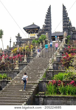 Besakih Indonesia - September 9 2017: Visitors explore the immense Pura Besakih Temple (Royal Temple of Besakih). the most important temple and holiest Hindu temple in Bali.