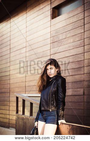 Pretty teenage girl posing on the street