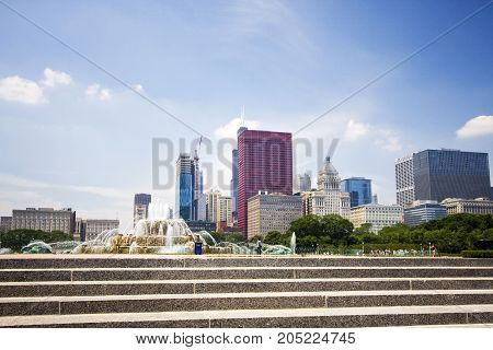 Chicago downtown skyline view with staircase and Buckingham fountain in Grant Park on the foreground on a sunny summer day.