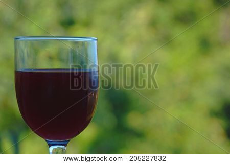 Red wine in the open air.  The background image is red wine accompanied by landscape