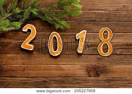 Figures 2018 On The Wooden Background Under The Fir Branch, At The Top Of The Frame. Space For Text