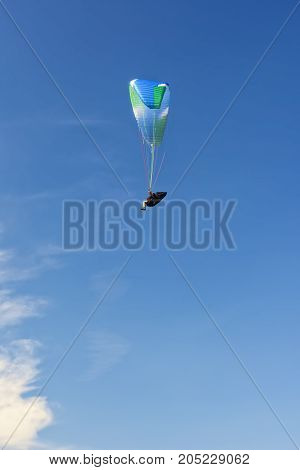 Skydiver in the clouds. Bright sports background