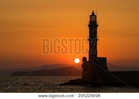 Picture of lighthouse sihoulette in the sunset.