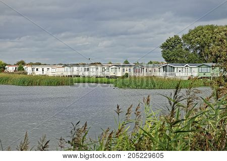 A village of holiday chalets beside a lake in the UK