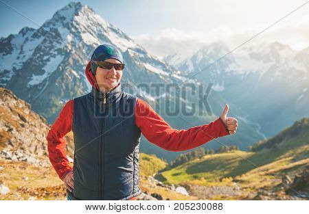 Happy Woman Hiker On The Top Of Mountain And Showing Thumbs Up