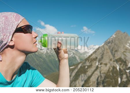 Hiker Woman Drinking Water On The Top Of Mountain