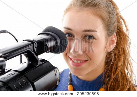young woman with a video camera isolated on white background