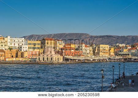 Chania Greece - August 2017: Chania harbour with colorful buildings Greece