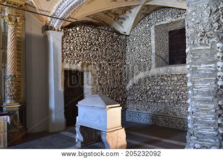 Evora Portugal - June 12 2017: Chapel of the Bones (Capela dos Ossos) with human bones and skulls in the wall is one of the best known monuments in Evora