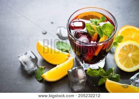 Sangria cocktail with fruit mint and ice. Traditional alcoholic cocktail. Summer drink.