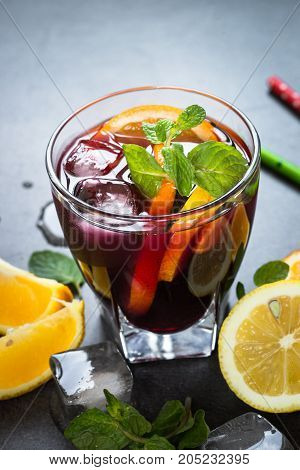 Sangria with fruit mint and ice. Traditional alcoholic cocktail. Summer drink.