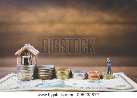 Miniature People Businessman On Money