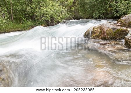 beautiful river in the mountains . In a park in the nature