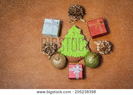Christmas gingerbread cookie balls gifts and pine cones.