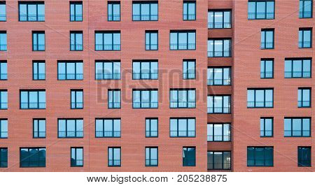 frontal view of Architectural Exterior Detail of Residential Apartment Building with Brick Facade