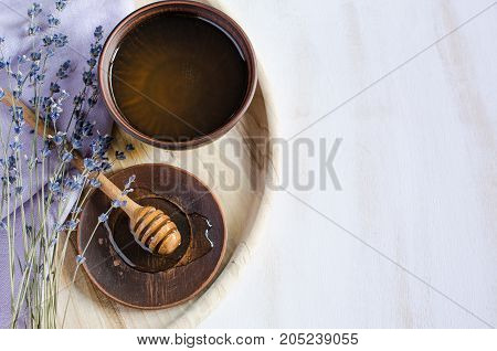 Organic honey and lavender flowers on wooden table. Rustic stile.