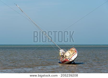 Sailing boat at low tide resting on its side