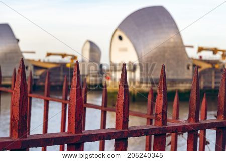 Rusty Gate With Thames Barrier In The Background