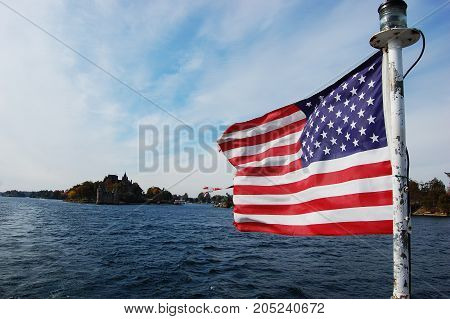 USA National Flag on St. Lawrence River in Thousand Islands, New York, USA.