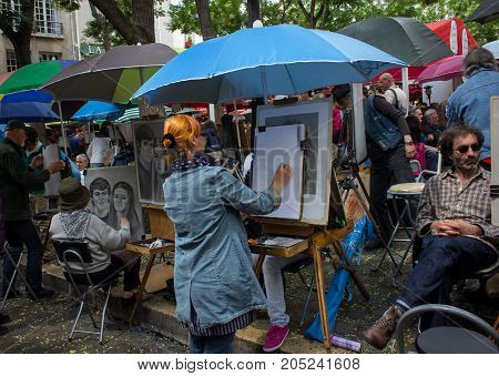 Paris France - July 24 2011: Street artists sell their painting in Place du Tertre