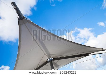 Awning In Sail Shape Under Cloudy Sky