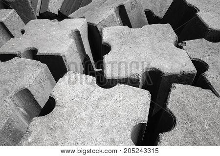 Rough Gray Concrete Blocks. Breakwater Structure