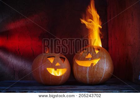 Halloween pumpkins on wooden table on dark background