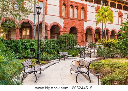 Saint Augustine Florida USA - January 18 2016: The inner courtyard of Flagler College with alleys and benches