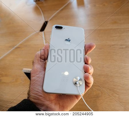 New Iphone 8 And Iphone 8 Plus In Apple Store With Holding Iphone