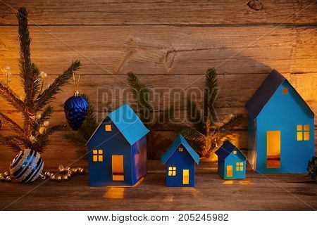 the blue paper houses with Christmas decoration