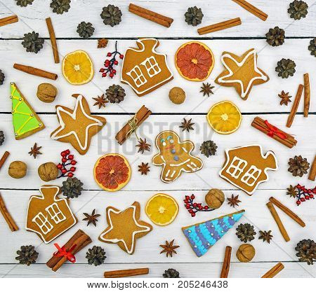 Celebratory background. Gingerbread, spices, decor on a wooden background. top view. Christmas.