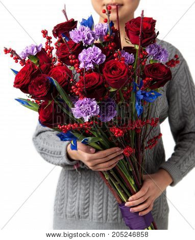 woman holds bouquet of red roses. Valentine's Day