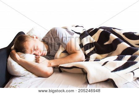 handsome guy hipster sleeping in her white bed dream about happy life