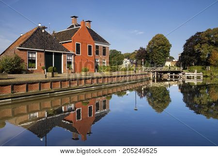 The village Onderdendam on the Boterdiep canal in the Dutch province Groningen