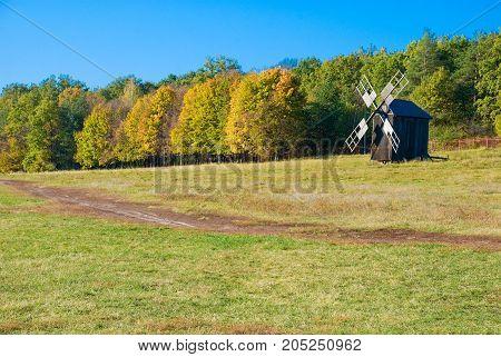 Antique ramshackle wooden windmill Pirogovo Kiev Ukraine