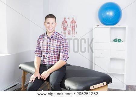 A nice physiotherapist rehabilitating at job office